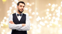 man in party clothes and bowtie