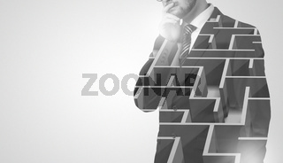 Businessman standing and thinking  with maze