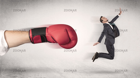 Businessman gets fired by a huge boxing hand