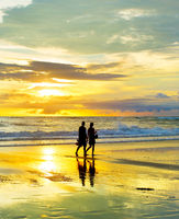 Couple walking by the  beach