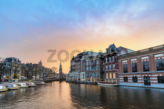 Amsterdam Netherlands, sunset city skyline at canal waterfront