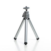 Small mini tripod isolated on white background. Photography and video concept.