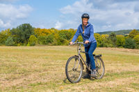 European woman on mountain bike in german nature