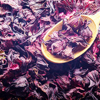 Top view of Dry Hibiscus petals in wooden spoon background closeup