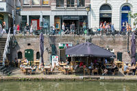 Dutch city Utrecht with shopping people and terrace along canal