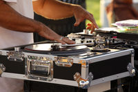 Turntable, hand of dj on the vinyl record