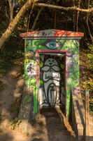 COPENHAGEN, DENMARK - October 2018: Small shed with grafitti by the canal in Freetown Christiania, a self-proclaimed autonomous neighbourhood in Copenhagen.