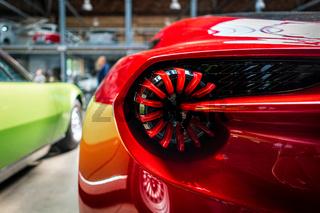 Stoplights of sports car Aston Martin V12 Zagato, close-up.