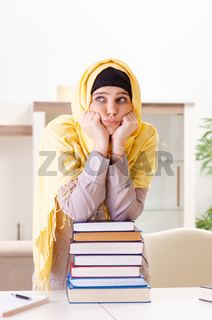 Female student in hijab preparing for exams