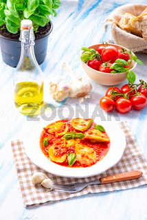 Delicious pasta - ravioli in tomato sauce with basil