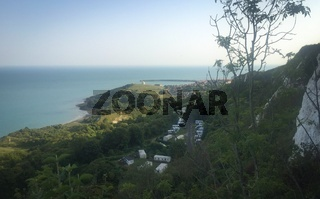 View at white cliffs of Dover, grass, trees and rocks