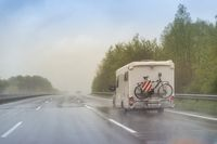 Mobile home on the highway in the rain