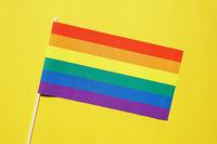 rainbow flag gay or lgbt pride symbol on yellow background