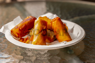 spring rolls delicious fresh baked dish of asian cuisine. Dish of ready spring rolls with meat delicious