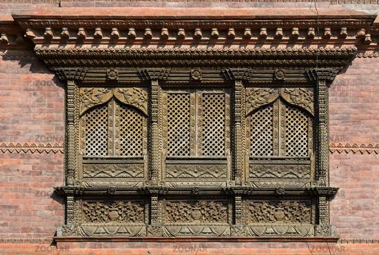 Elaborately carved wooden windows in the traditional Newar style, Kathmandu, Nepal