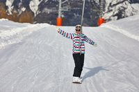 Female snowboarder using ski lift