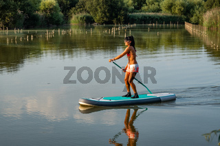 Woman stand up paddleboarding