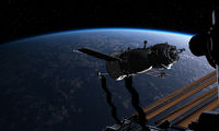Spacecraft and spacestation at the Earth orbit