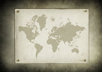 Vintage world map parchment nailed to a wall