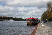 Dutch canal near Utrecht with sailing and moored ships