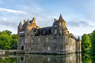 historic Chateau Trecesson castle in the Broceliande Forest with reflections in the pond