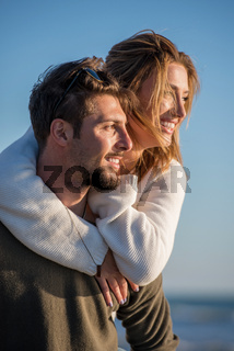 couple having fun at beach during autumn