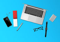 Office desk mockup top view isolated on blue
