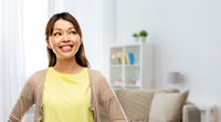 happy asian woman looking up at home