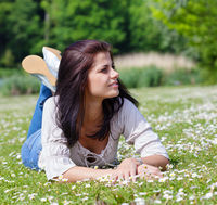 Young woman enjoying summer sunny day in a park