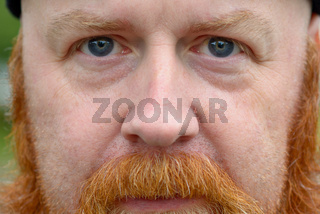 Close up cropped portrait of a redheaded man