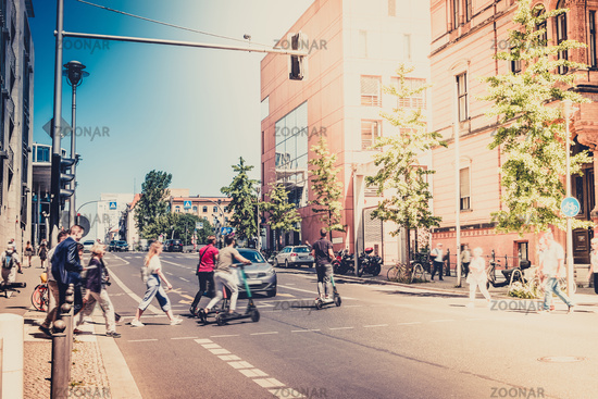 unrecognizable people crossing road at traffic light  - City traffic concept