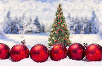 Christmas baubles with christmas tree and winter landscape