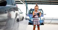 Little girl washing auto in self-serve car wash