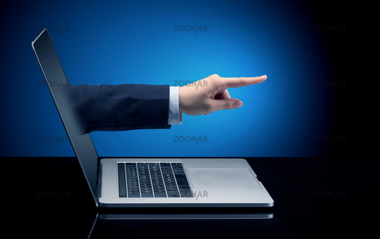 Hand coming out of a laptop