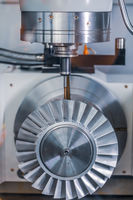Metalworking CNC lathe milling machine. Cutting metal modern processing technology.