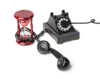 Vintage telephone and hourglass