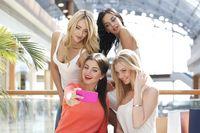 Friends taking selfie in shopping mall
