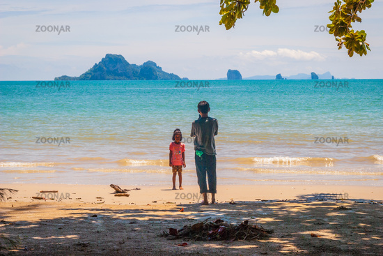 Kids taking photos on the beach