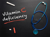 The words Vitamin C deficiency on a chalkboard
