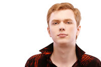 red-haired young man close-up in a red shirt isolated on white background