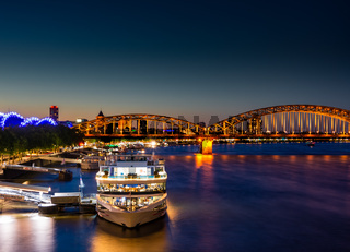 Illuminated passenger ships at the river Rhine in Cologne