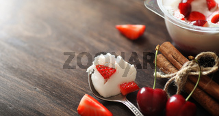 Fresh yogurt with berries. Ice cream in a bowl with fresh and ju