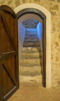 Stairs, Interior of a medieval castle in Toledo, Spain. Stone rooms with wooden furniture, medieval period of the Spanish reign