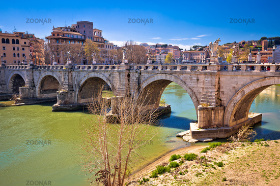 Ancient Ponte Sant Angelo stone bridge on Tiber river of Rome