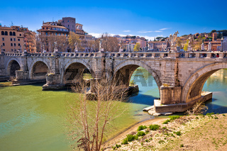 Ancient Ponte Sant Angelo stone bridge on Tiber river of Rome