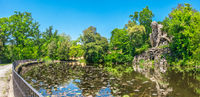 The majestic big statue of Colosso dell Appennino giant statue and pond in public gardens of Pratolino near Florence in Italy - panoramic wide shot