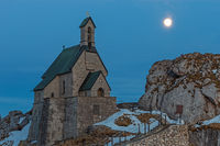 Small chapel on the summit of Wendelstein mountain at full moon