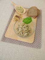 Homemade vegan spread from peeled hemp seeds, nuts and herbs