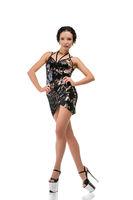 Slim brunette in tinsel dress dancing shot