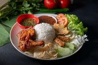 Nasi lemak kukus with fried drumstick